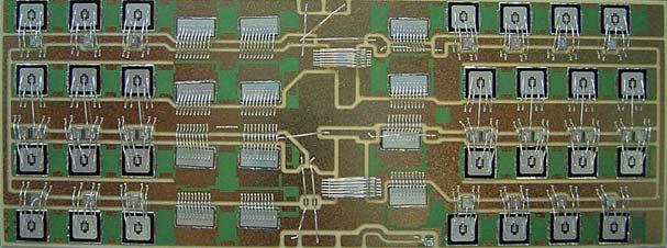 Рис. 11. Подложка модуля SKiiP (3600 A, 1200 В) размером 140x53 мм с установленными чипами IGBT и диодов