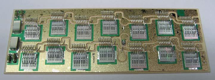 Рис. 23. Подложка с установленными семью чипами MOSFET (100 A, 100 В), RC-фильтрами и датчиком температуры