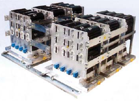 Рис. 1. Инвертор для ветрогенератора фирмы SEMIKRON. На рисунке видны силовые модули SKiiP IGBT и многослойные шины питания с установленными на них конденсаторами