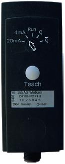 Рис. 4. Тыльная сторона датчика DT60 с кнопкой настройки Teach и индикатором выбора режимов